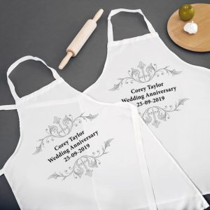 Fun personalised anniversary aprons for the couple.