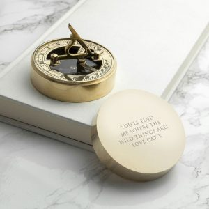 Buy him a brass sundial and compass for this anniversary gift