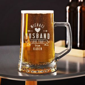 Buy him a personalised beer tankard for his anniversary gift.
