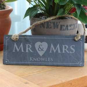 Buy a personalised Mr & Mrs slate plaque for their wedding anniversary.