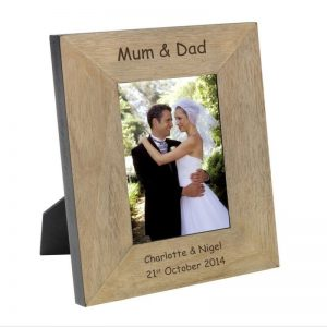 Buy mum and dad a personalised wooden picture frame.
