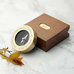 Buy him a personalised travelers compass for this anniversary gift.