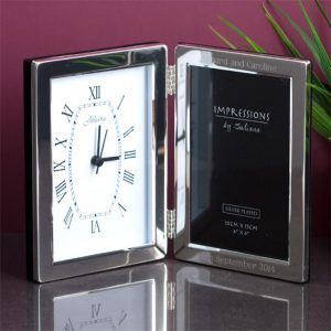 Buy him a silver picture frame with clock for his 23rd wedding anniversary