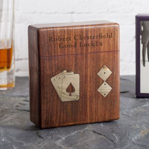 Buy them a personalised wooden boxed playing cards and dice set for this anniversary gift