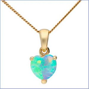 Buy her a gold and opal heart shaped pendant.