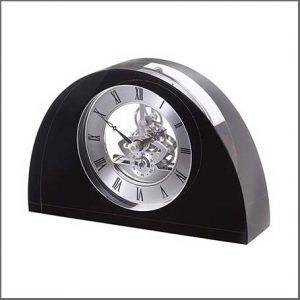 Buy them a stylist half moon clock from dartington crystal.