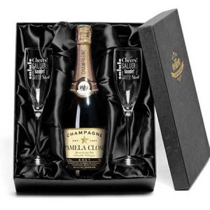 Buy them some personalised champagne and flutes for their anniversary gift.