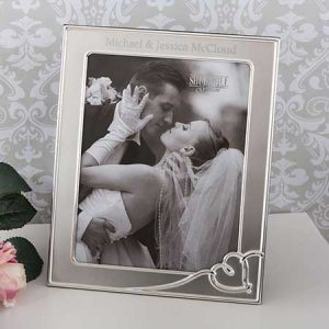 Buy her a personalised silver heart photo frame.