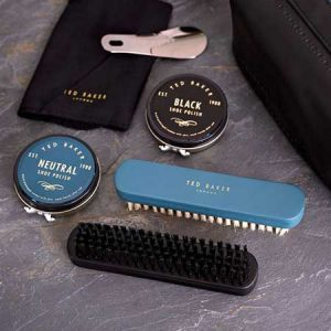 Buy him a Ted Baker shoe shine kit for his anniversary gift.