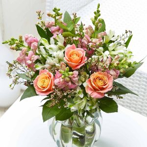 Buy her a bouquet of antique roses as this anniversary gift.