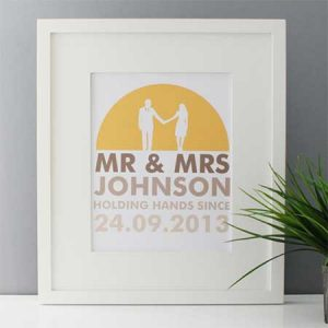 Buy them a Mr & Mrs holding hands since framed print.