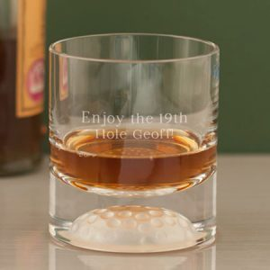 Buy him a personalised golf ball whisky tumbler.