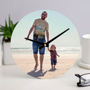 Buy her a personalised photo upload clock for her anniversary gift.