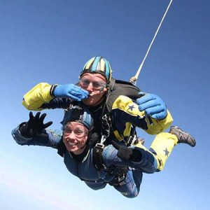 Buy her a tandem skydive in Devon.