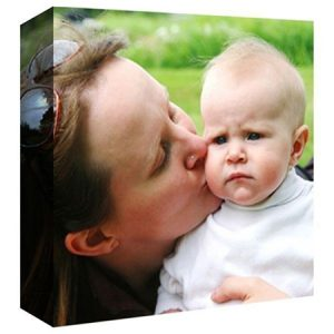 Buy them your own photo on canvas gift, use a family photo.