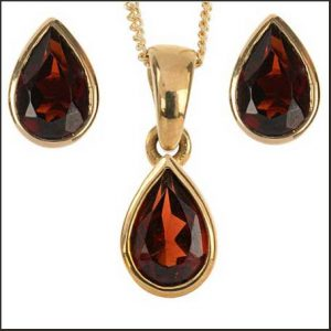 Buy her the garnet pendant and earrings set for this anniversary gift.