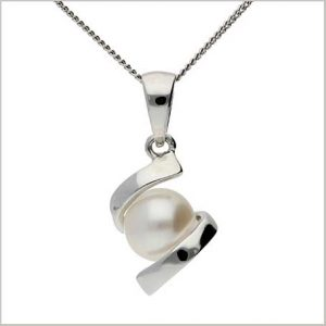 Buy her a Pearl and white gold pendant.