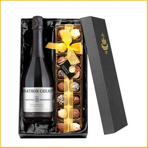 Buy her a personalised bottle of prosecco with chocolates.
