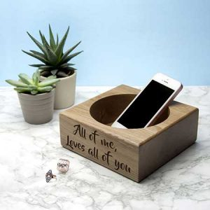 Buy her a personalised oak stash tray.