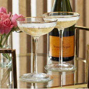 Buy them a pair of champagne saucers for this anniversary gift
