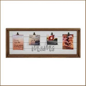 Buy them this wooden mr and mrs multi clip frame for their anniversary gift
