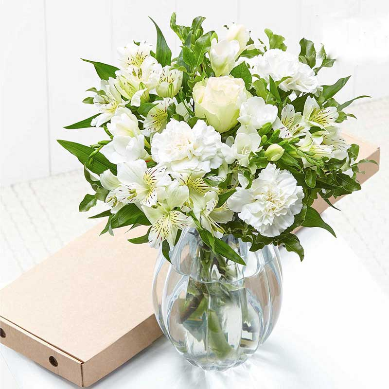 Buy this beautiful bouquet of white freesia and roses for this anniversary gift.