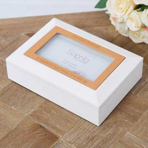 Buy her this personalised white and copper jewellery box.