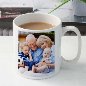 Buy him a photo mug with a favourite photo for his 2nd anniversary gift