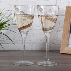Buy them a personalised pair of swirl wine glasses for their anniversary gift