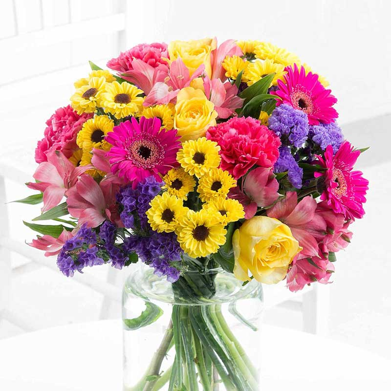 Buy these vibrant summer bouquet of flowers for this anniversary gift