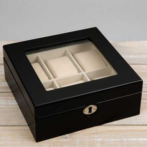 Buy him the watch collection box, holds 6 watches for his anniversary gift.