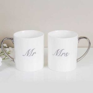 Buy them these Amore Set of Mr & Mrs China Mugs for this anniversary gift