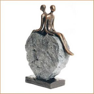 Buy her this Harmony Couple Sitting on a Rock Heart Sculpture for her 30th anniversary gift