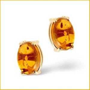 Buy her these 18k gold and amber earrings for this anniversary gift.