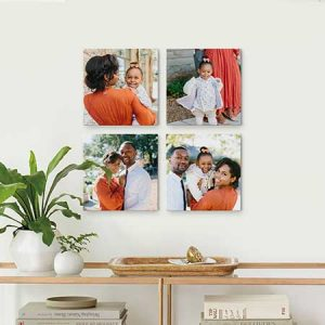 Buy her a set of 4 canvas prints from your favourite photos, great anniversary gift