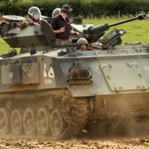 Buy him a tank driving experience day for this anniversary gift