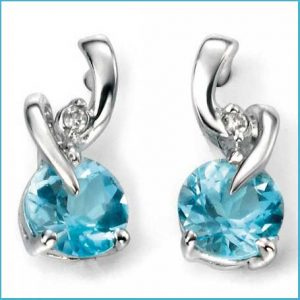 Buy her these White Gold Blue Topaz And Diamond Earring for this anniversary