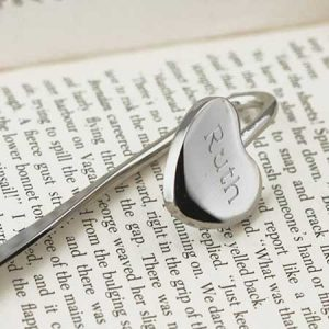 Buy her this name engraved heart shaped bookmark for this anniversary gift