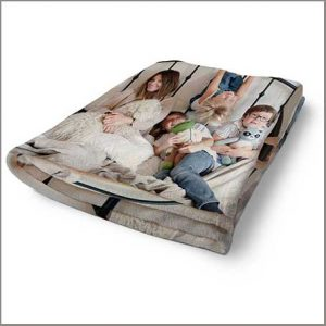 Buy them a fleece blanket with a photo of your family for this anniversary gift