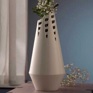Buy her this Horsetail Vase By Wendy Ward with some flowers to go inside for this anniversary gift