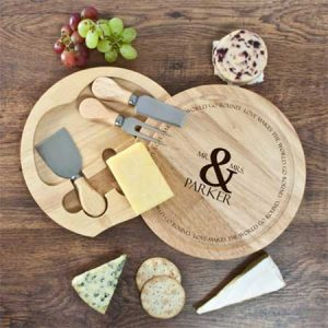 Buy them this personalised round cheese board set for this anniversary gift