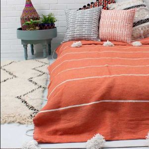Buy them a Moroccan Pom Pom Blanket for this anniversary gift