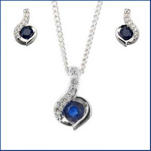 Buy her this Gold Sapphire & Diamond Pendant & Earrings Jewellery Set for her 45th anniversary gift