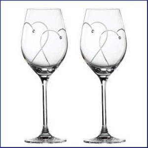 Buy them Promises Two Hearts Entwined Wine Glasses for this anniversary gift