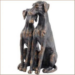 Buy him the Puppy Love Sitting Dogs Sculpture for this anniversary gift