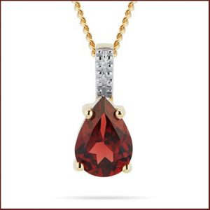 Buy her this Yellow Gold Garnet Diamond Pear Pendant for this anniversary gift