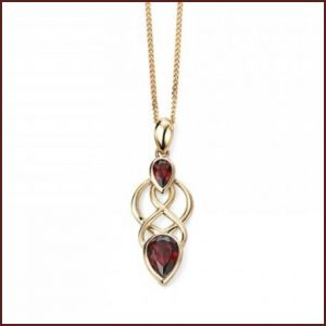 Buy her this gold and drop garnet pendant for this anniversary gift