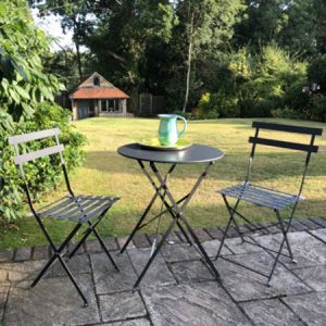 Buy them the Lilliput Bistro Garden Set for this anniversary gift, The bistro table and chairs both fold away and store flat, allowing space for garden activities