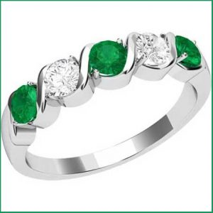 Buy her the Emeralds & Diamonds eternity ring, Add a splash of colour to her fine jewellery collection for this anniversary gift