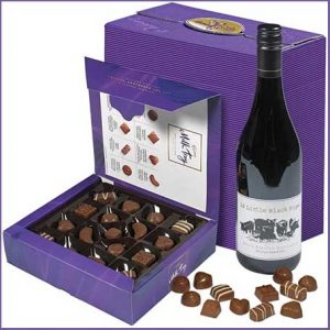 Buy him the Cadbury Milk Tray and Red Wine gift box for this anniversary